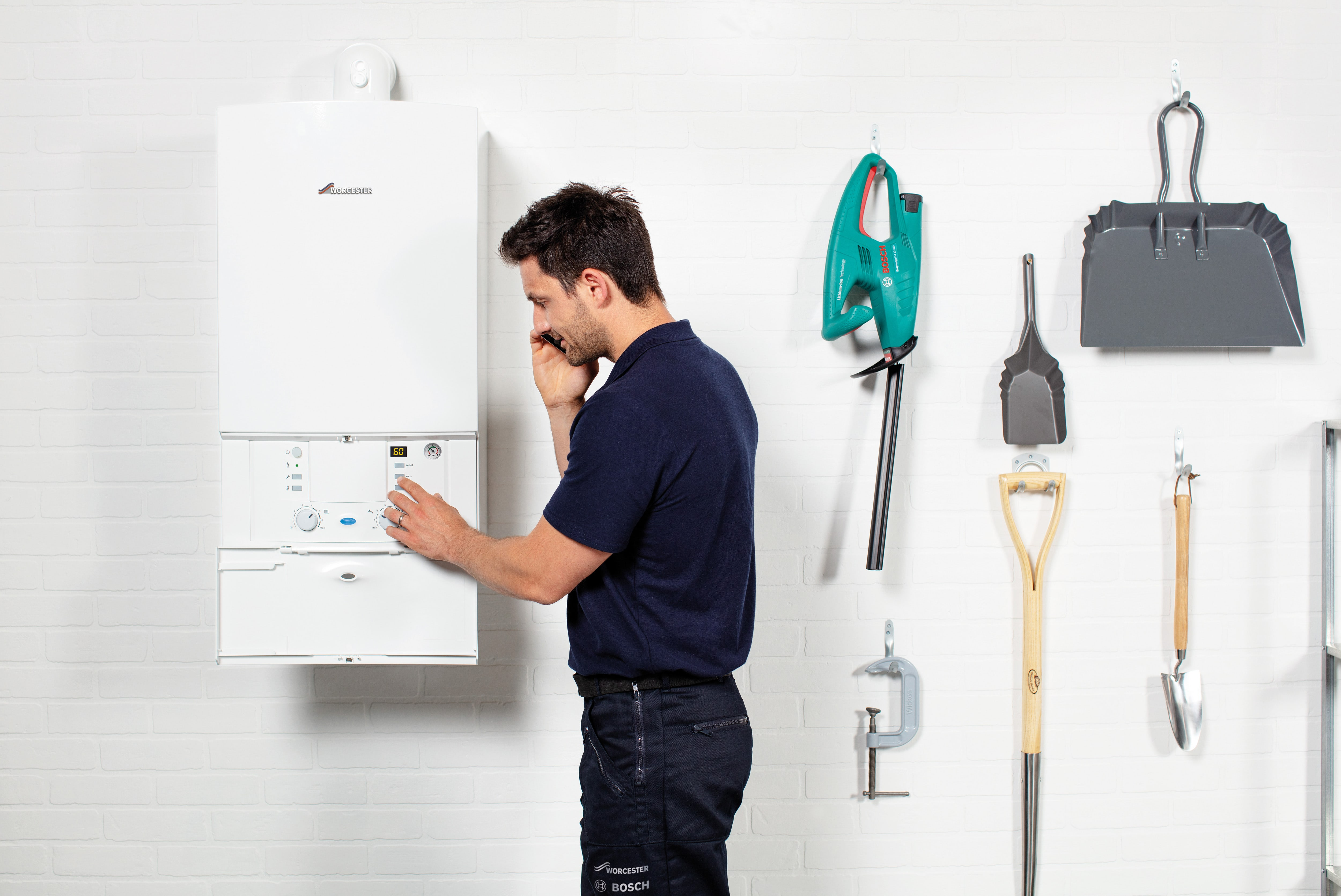 Engineer fixing a broken boiler